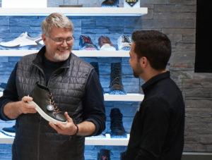 ECCO customer holding shoe